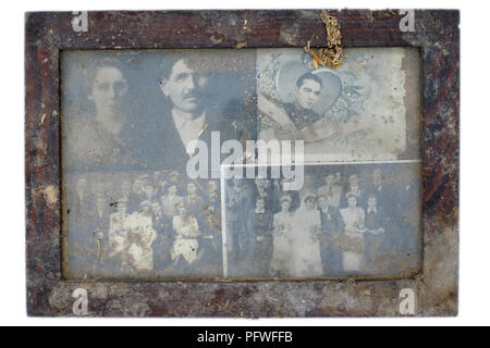 dirty dusty wooden frame containing four wedding photographs from the 1930s hungary - Stock Image