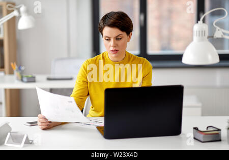 creative woman working on user interface at office - Stock Image
