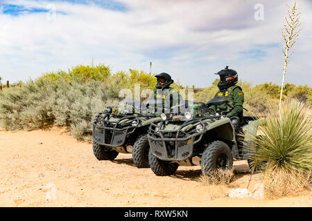 United States Customs and Border Protection (USCBP) officers guard the US-Mexico international border near the Santa Teresa Port of Entry in New Mexico on quad bikes. See more information below. - Stock Image