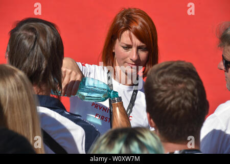 Karlovy Vary, Czech Republic. 28th June, 2019. The 54th Karlovy Vary International Film Festival begins on June 28, 2019, in Karlovy Vary, Czech Republic. On the photo a medical worker gives water to people waiting for the red carpet. Credit: Slavomir Kubes/CTK Photo/Alamy Live News - Stock Image