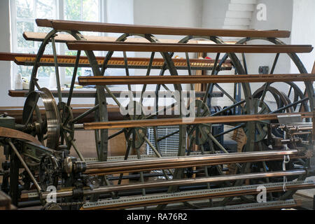 Whitchurch Silk Mill in Hampshire, UK. A historic wooden creel, a rack holding bobbins or spools when spinning. - Stock Image