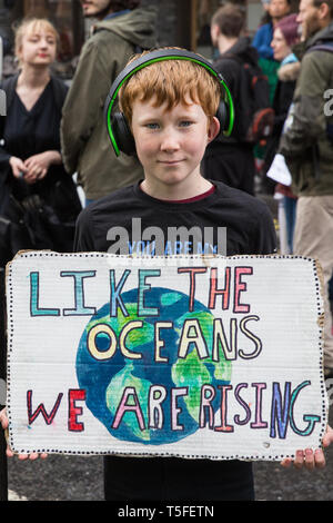 London, UK. 24th April 2019. A young climate change activist from Extinction Rebellion blocks Victoria Street on the tenth day of the International Re - Stock Image