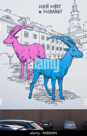 Poznan Poland city street, view of a huge image on the side of a building depicting the goats Pyrek & Tyrek - the historical mascots of Poznan city. - Stock Image