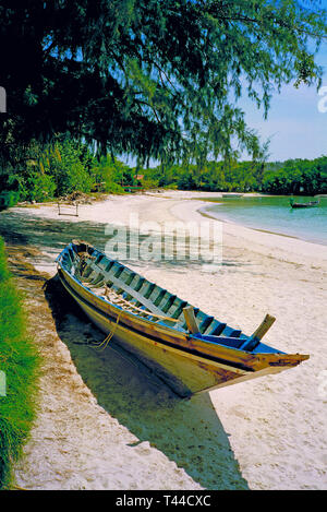 Koh Samui Thailand - a semi-derelict longboat drawn up on a beach - Stock Image