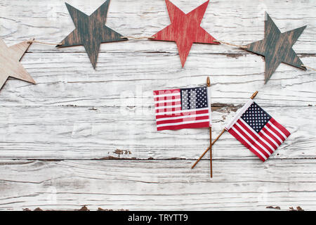 Fourth of July Background. Wooden stars with American flags over a white rustic background to celebrate America's Independence Day. - Stock Image