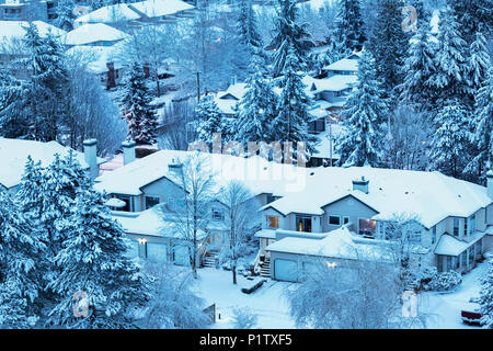 Snow covering house rooftops and houses in winter; Surrey, British Columbia, Canada - Stock Image