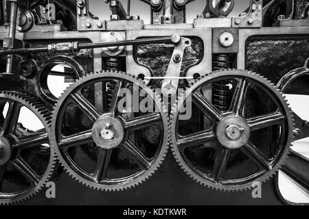 Industrial machine cogs in black and white. - Stock Image