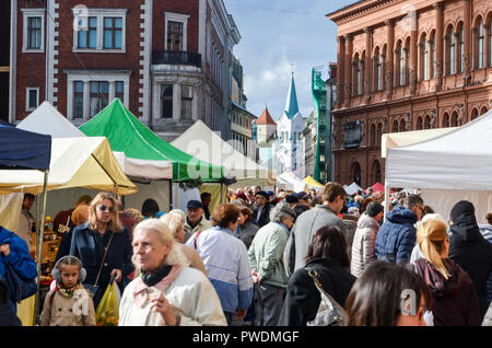People on Dome Square of Riga, Latvia, during market hours - Stock Image