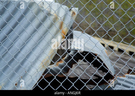 Corrugated metal and chain link fence - Stock Image