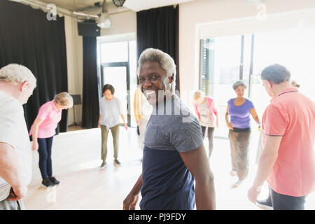 Portrait smiling, confident senior man exercising in circle - Stock Image