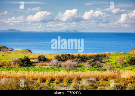 From above view of a meadow field sea sky and clouds in Gumusluk, Bodrum Mugla Turkey - Stock Image