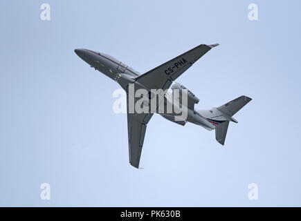 An Embraer EMB505 Phenom 300 climbs out from Inverness airport in the Scottish Highlands. - Stock Image