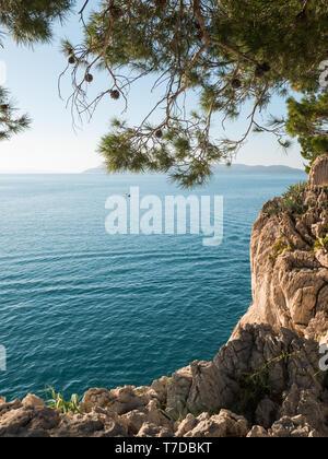 Scenic rocky coastline in Croatia on sunny summer day - Stock Image