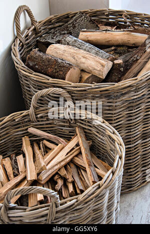 Firewood in basket at home - Stock Image