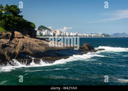 View to Ipanema from rocky shore in Rio de Janeiro, Brazil - Stock Image