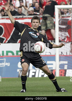 Tomasz Bandrowski of Cottbus controls the ball during the DFB Cup 1st Round match Rot-Weiss Essen v Energie Cottbus - Stock Image