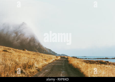 Foggy mountains road landscape in Norway Travel background scenery nature calm misty view minimal style - Stock Image
