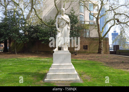 Commemorative statue to William Huskisson, the first person to killed by a train in 1830, which stands in Pimlico Gardens on the north bank of the Riv - Stock Image