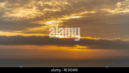 Sunset behind a rain shower over the atlantic ocean. - Stock Image