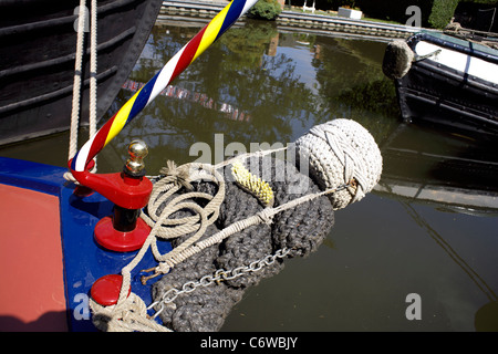 Stack of four button, fenders, on, the, stern of, a, narrowboat, rear, stern, aft, fender, colourfully painted narrowboats - Stock Image