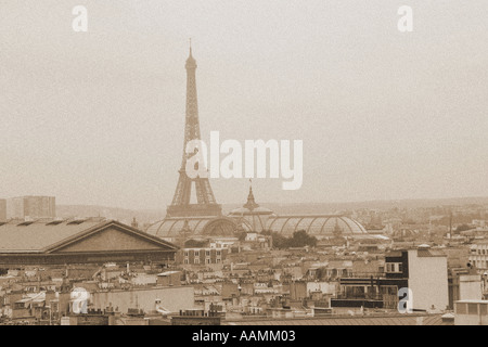 Sepia landscape shot of Eiffel Tower across rooftops of Paris France - Stock Image