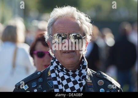 Chichester, West Sussex, UK. 14th Sep, 2013. Goodwood Revival. Goodwood Racing Circuit, West Sussex - Saturday 14th September. Close-up portrait of a grey-haired Rocker wearing mirror sunglasses and a checkered scarf over his leather jacket. Credit:  MeonStock/Alamy Live News - Stock Image