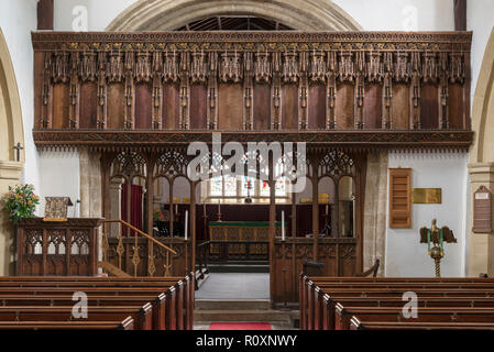 An intricately carved 16th century Rood Screen preserved in St. Oswald's Church, Flamborough, Yorkshire, UK - Stock Image
