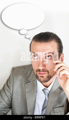Businessmen with thought bubble - Stock Image