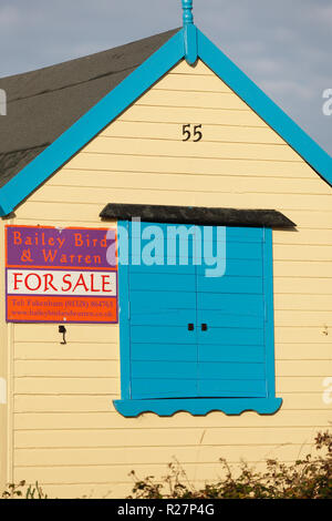Beach hut for sale on the Norfolk coast. - Stock Image