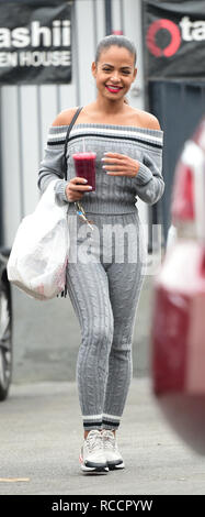 Christina Milan goes out for lunch with a friend in a cable knit two piece outfit  Featuring: Christina Milian Where: Los Angeles, California, United States When: 14 Dec 2018 Credit: WENN.com - Stock Image