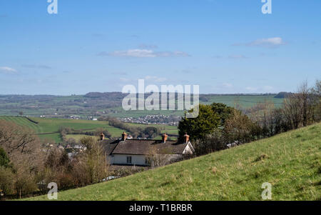 House built into hillside near Colyton, Devon, with fields and open countryside, beautiful views. - Stock Image