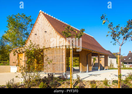New timber construction of village hall - France. - Stock Image
