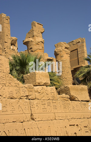 Stone Wall in the Temple of Karnak, Luxor, Egypt, Decorated with Hieroglyphics and Pictures of the Ancient Kings - Stock Image
