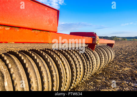 Detail of serrated roller on farming machinery. - Stock Image