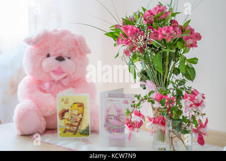 pink flowers, baby, pink teddy bear, celebration, congratulation, baby girl celebration - Stock Image