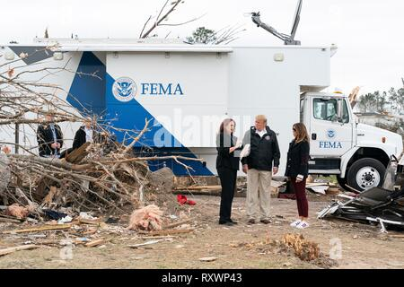 U.S First Lady Melania Trump and President Donald Trump view damage from a massive tornado March 8, 2019 in Lee County, Alabama. The region was hit by a tornado on March 3rd killing 23 people. - Stock Image
