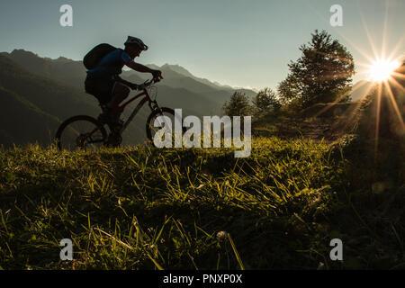 Mountain Biker at Sunset - Stock Image