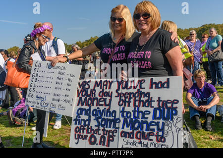 London, UK. 10th October 2018. Women from groups campaigning for women born in the 1950s to regain the pensions stolen from them under successive governments, including The Waspi Campaign (Women Against State Pension Inequality),  Back to 60, We Paid In, You Pay Out and others, meet in Hyde Park for a rally before going to protest at Parliament. Credit: Peter Marshall/Alamy Live News - Stock Image