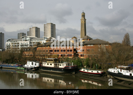 View of the North Bank of the River Thames from Kew Bridge with the Steam Museum Water Tower in the Background Brentford - Stock Image