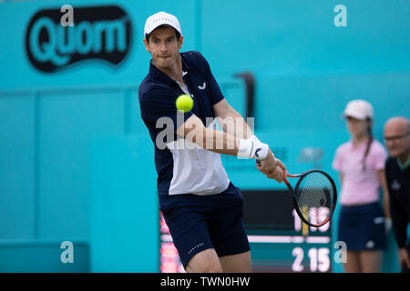Queen Club, London, UK. 21st June, 2019. The ATP Fever-Tree Tennis Tournament; Andy Murray (GBR) with a backhand shot to Daniel Evans (GBR) and Ken Skupski (GBR) Credit: Action Plus Sports/Alamy Live News - Stock Image