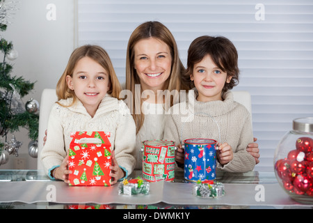 Mother And Children With Christmas Presents - Stock Image