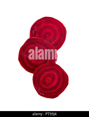 Slices of red beetroot against white background. Fresh young sliced beets. - Stock Image