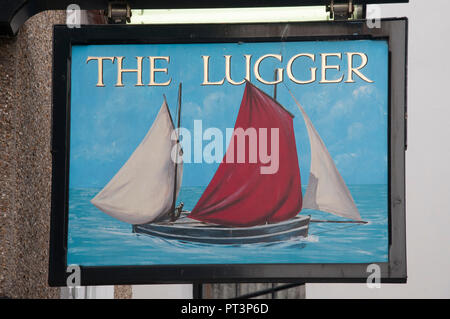 Sign outside the Lugger Inn in the seaside town of Fowey, Cornwall, England. A lugger is a type of traditional fishing boat along these coasts. - Stock Image