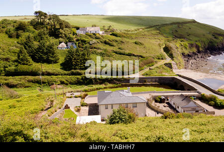 Image of country houses on the slopes of hills surrounding Ballyvoile Cove in County Waterford,Ireland. - Stock Image