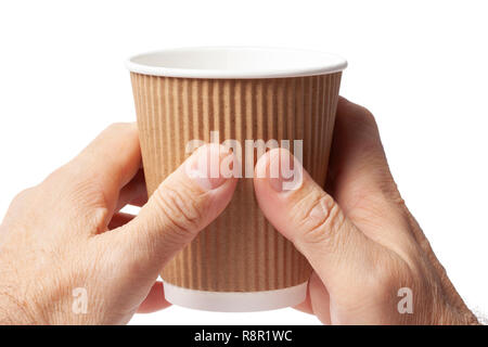 Carton cup of coffee in two human hands on white. - Stock Image
