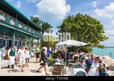 Miami Beach Florida South Pointe Park Smith & Wollensky restaurant steakhouse dining al fresco alfresco tables man men woman wom - Stock Image