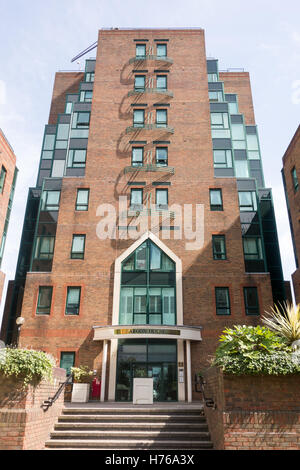 Aegon House is a block of residential apartments with small commercial businesses located on Lanark Square in Crossharbour, - Stock Image