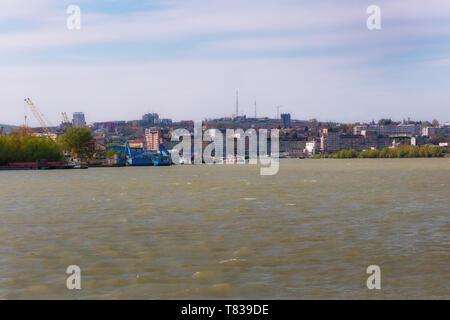 Danube River near Tulcea, Romania. Here begins the biosphere reserve Delta of the Danube. Walk with a small cruise ship. - Stock Image