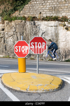 Stop signs and cyclist - Stock Image