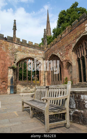 Inside the ruins of the historic St. Michaels - also known as Coventry Cathedral, which was destroyed in a bombing raid during the Second World War. - Stock Image